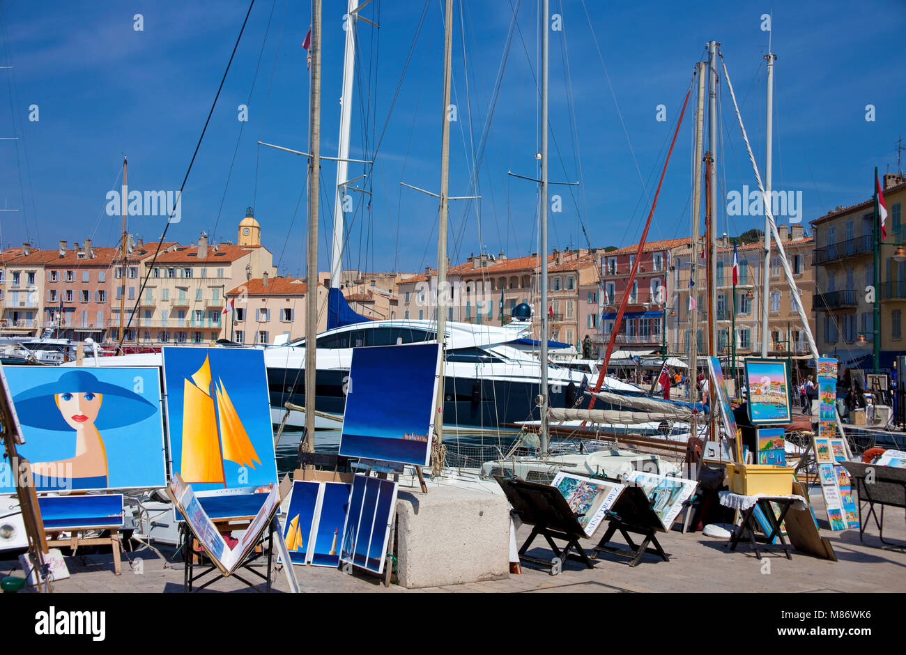 Paintings at strolling promenade at harbour of Saint-Tropez, french riviera, South France, Cote d'Azur, France, - Stock Image