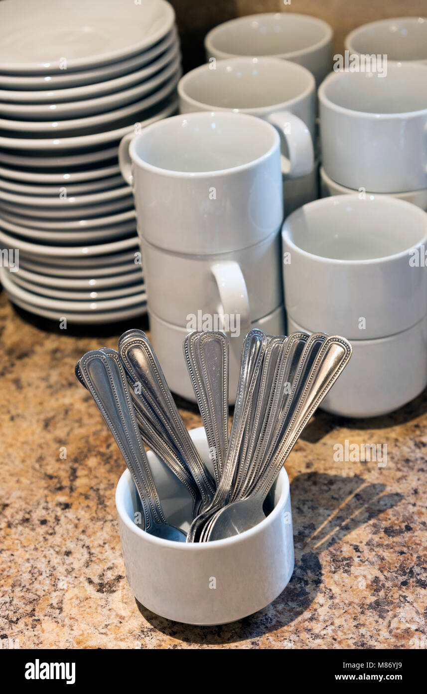 Cups, saucers and spoons. Catering supplies - Stock Image