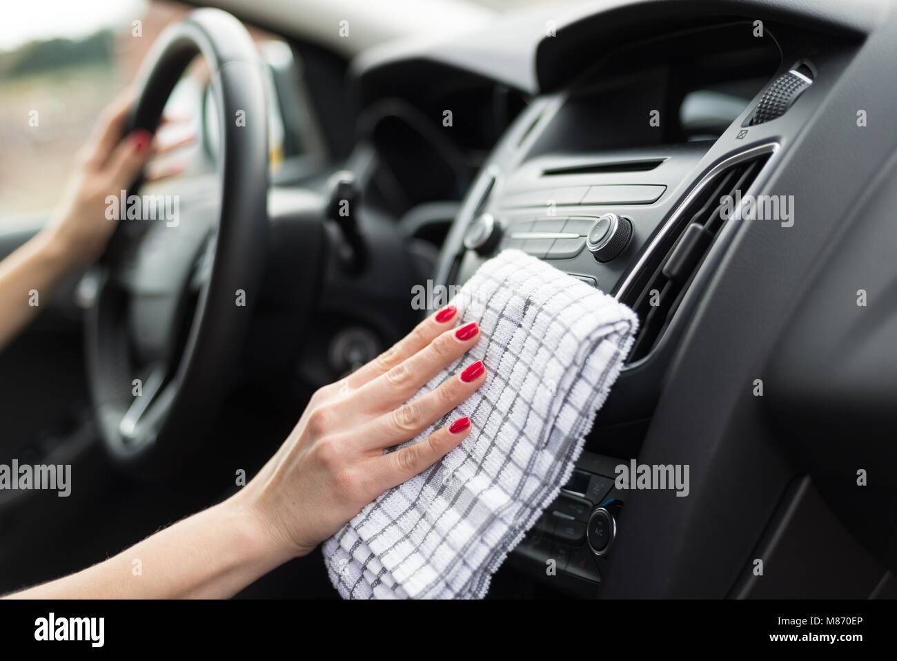 Woman Cleaning Car Dashboard. Modern Car Interior