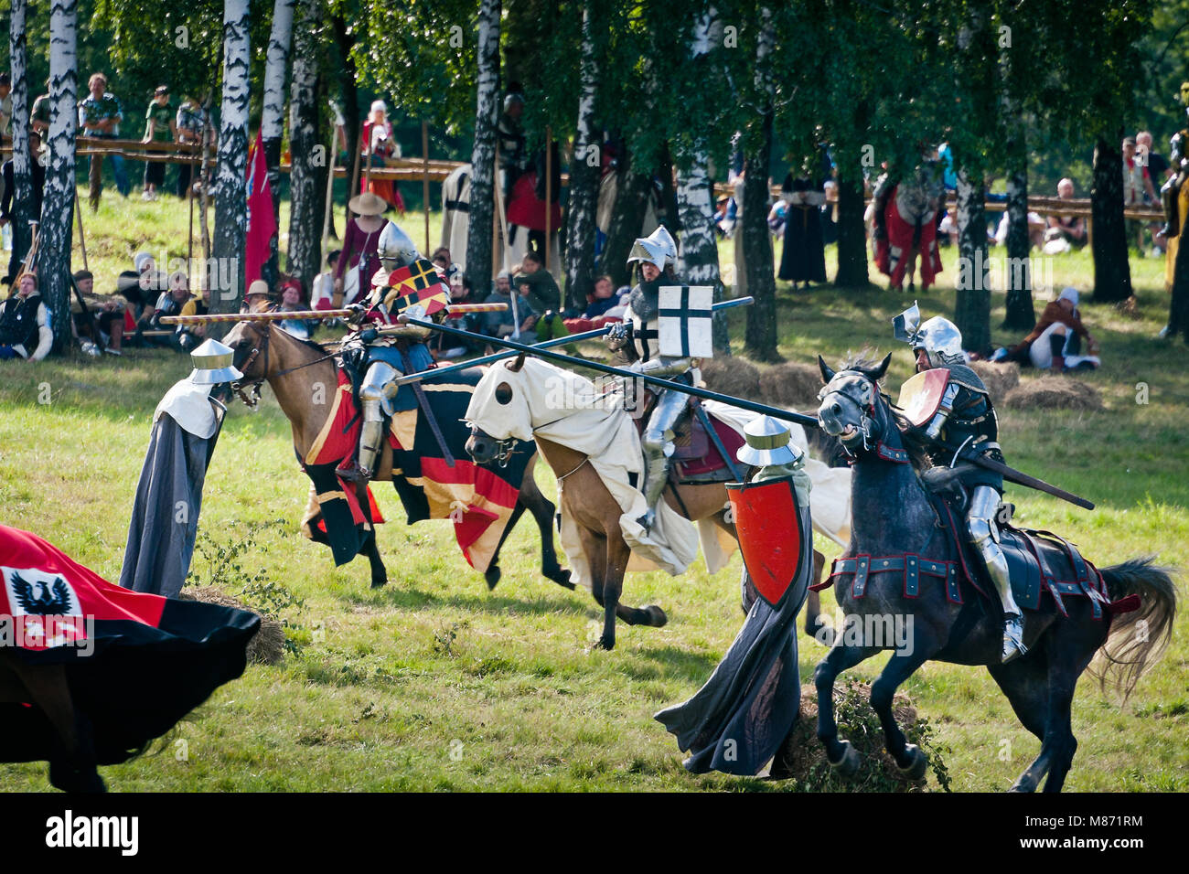 Lancer Knights charge - jousting at 601th anniversary of Battle of Grunwald 1410. 4000 reenactors, 1200 knights, Stock Photo