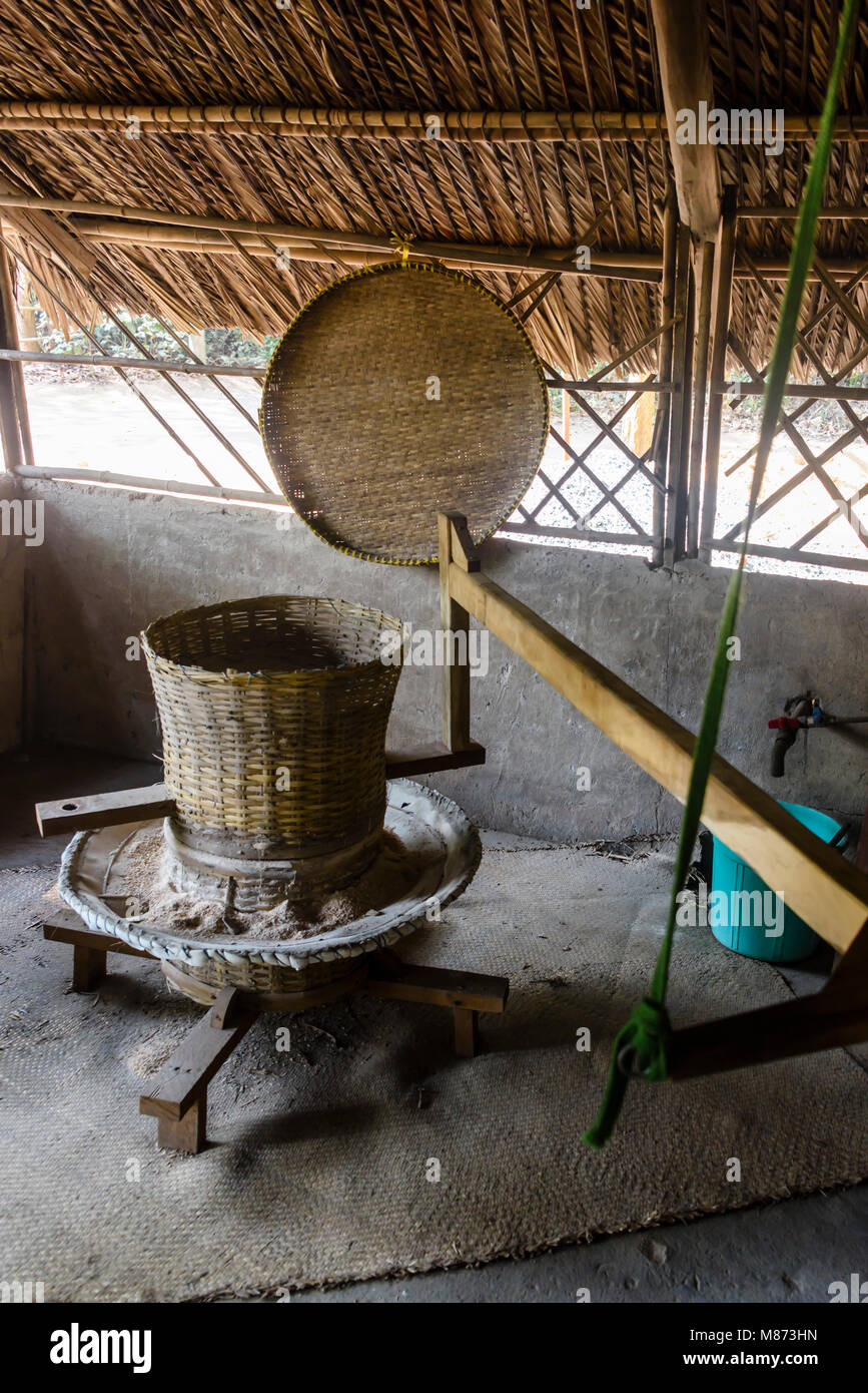 Grind stone used to grind rice in order to make rice paper and rice noodles. - Stock Image