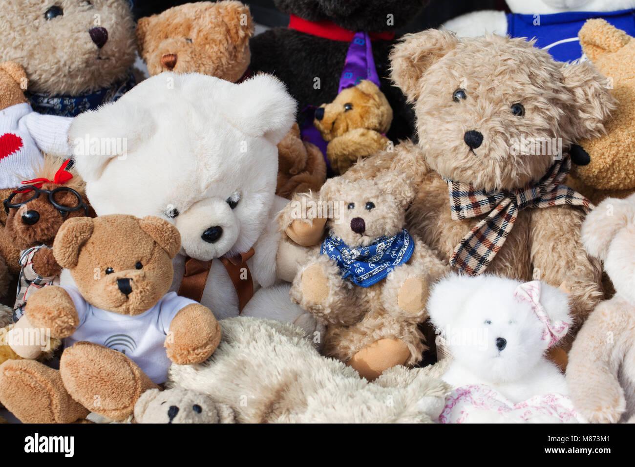 assortment of old teddies at flea market - Stock Image