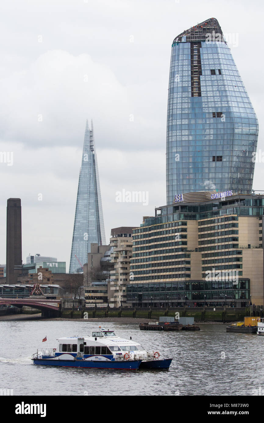 London, UK. 13th March, 2018. A Thames clipper passes along the river Thames in front of the Tate Modern, the Shard, Stock Photo
