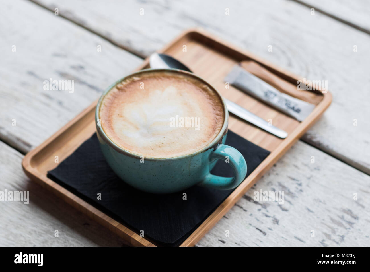 Cup of coffee latte, cappuccino trendy cafe - Stock Image