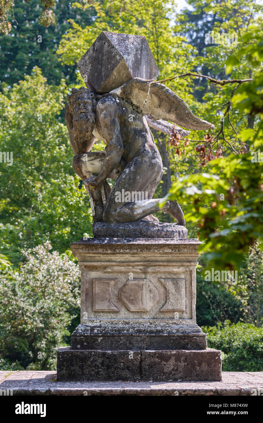 Valsanzibio, near Padua, Italy. A 17c statue of Time carrying a heavy burden, in the garden of Villa Barbarigo. - Stock Image