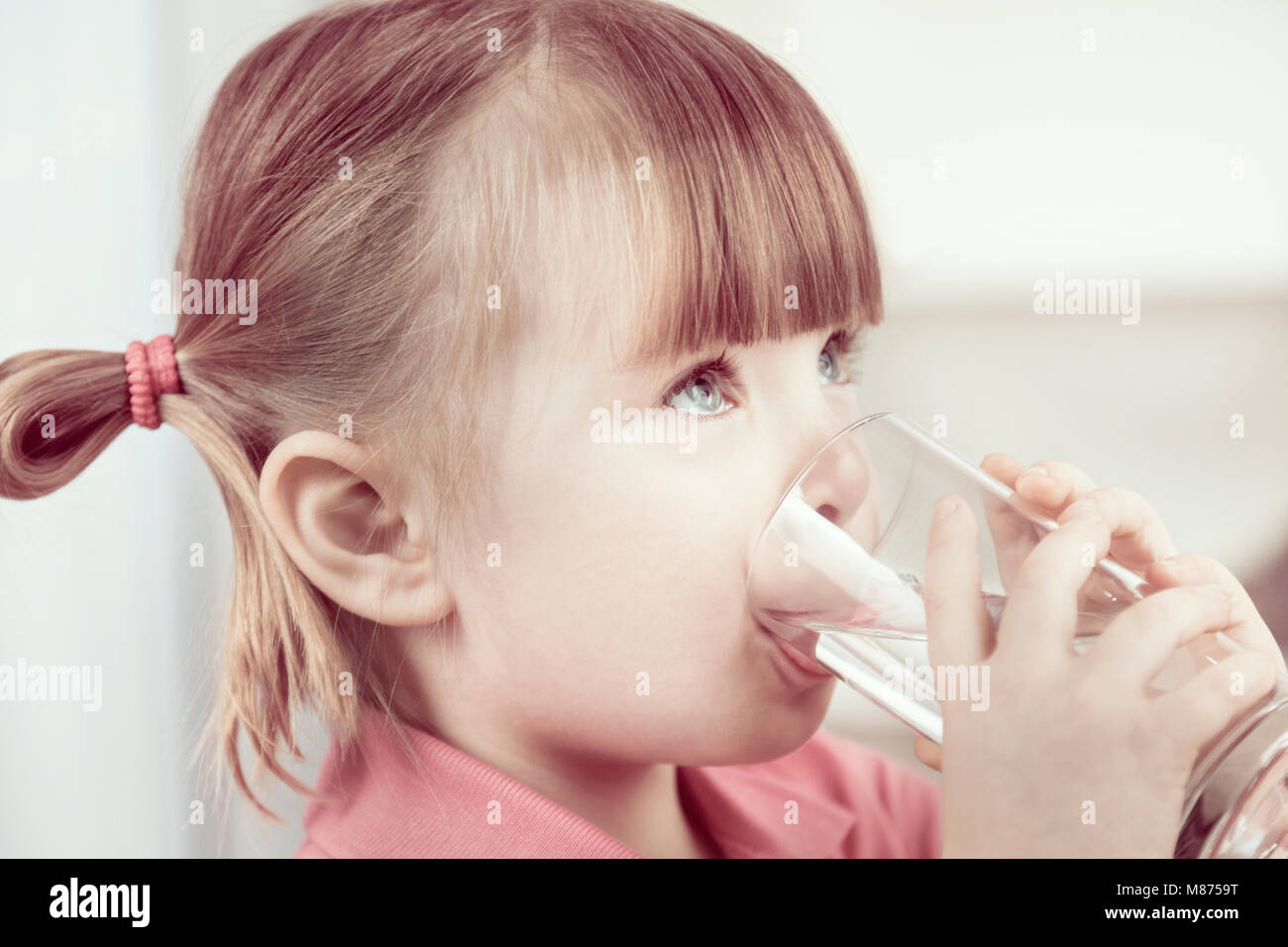Little girl drinking water - Stock Image