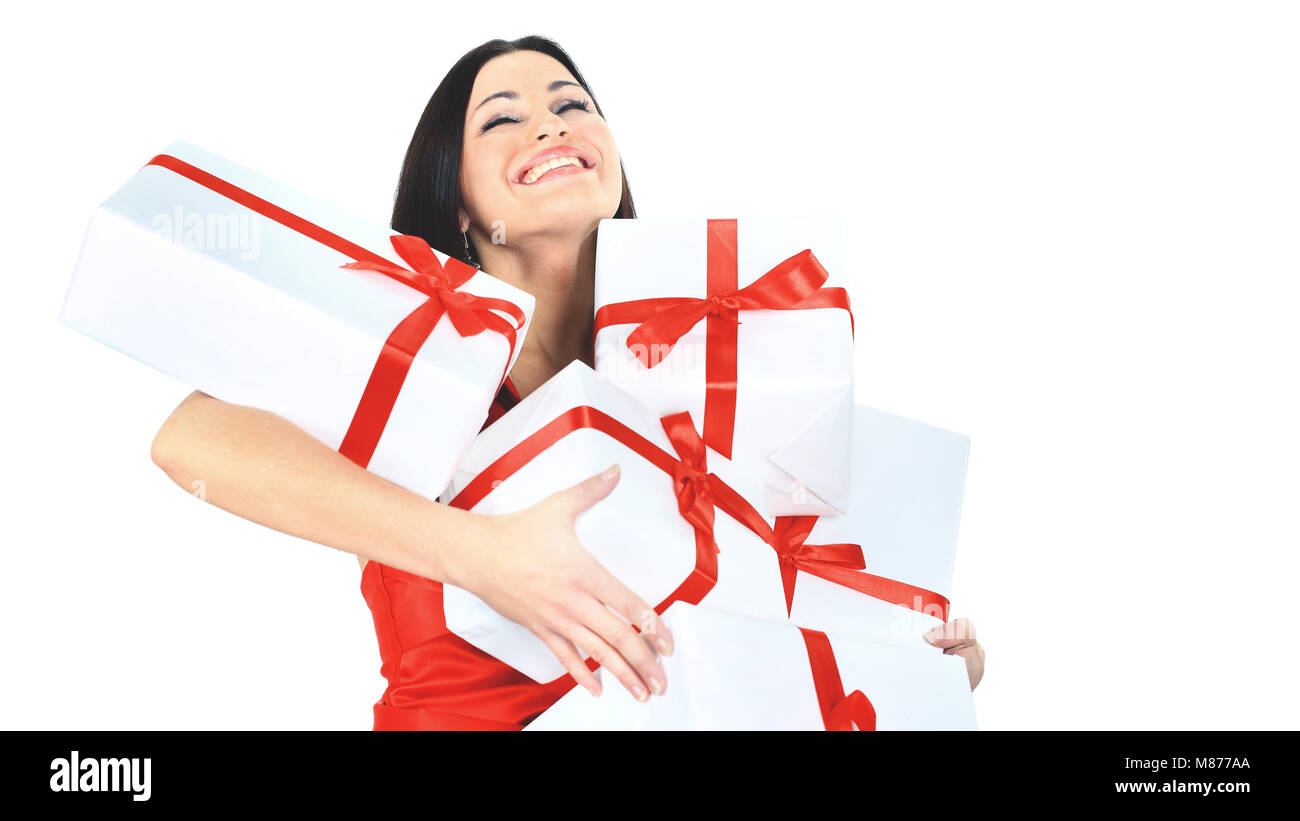 Young happy woman with a gift, closed her eyes  happiness and pleasure - Stock Image