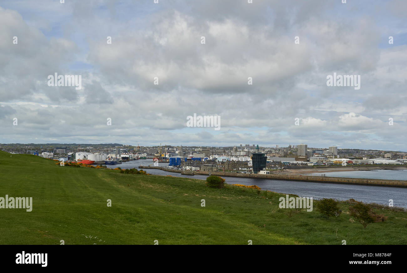 Aberdeen harbour, with the City beyond, taken from Torre which lies on the south bank of the River Dee. - Stock Image