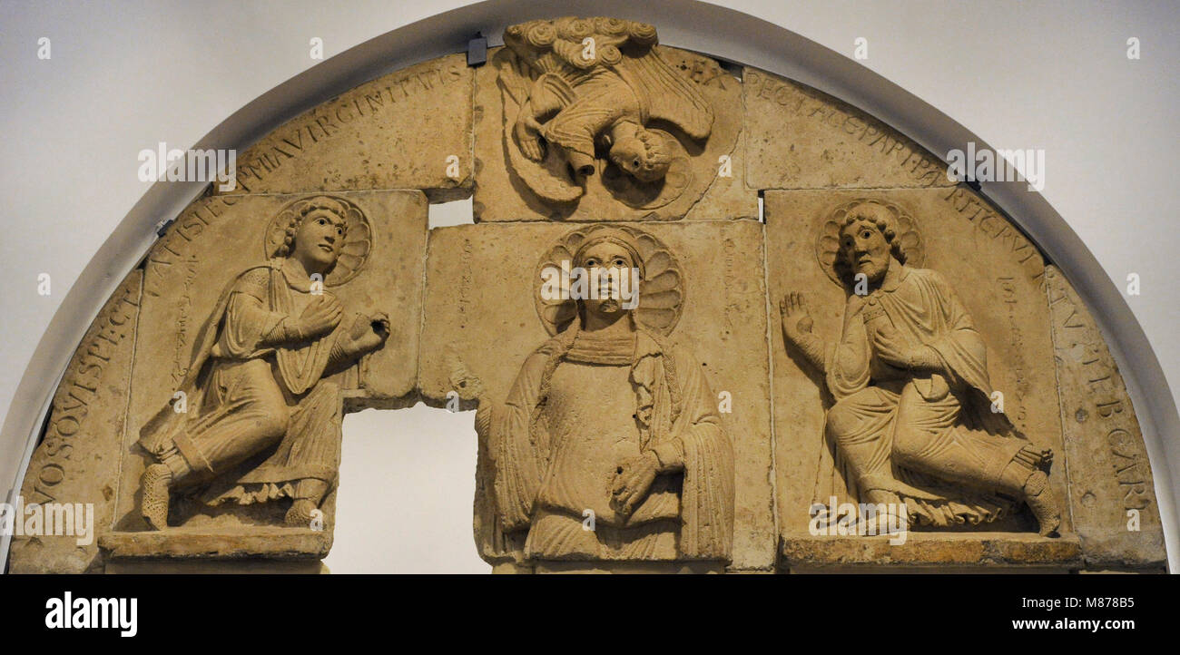 Tympanum from church of St. Cecilia. Cologne, Germany, c. 1160-1170. Limestone. Romanesque. Schnütgen Museum. - Stock Image