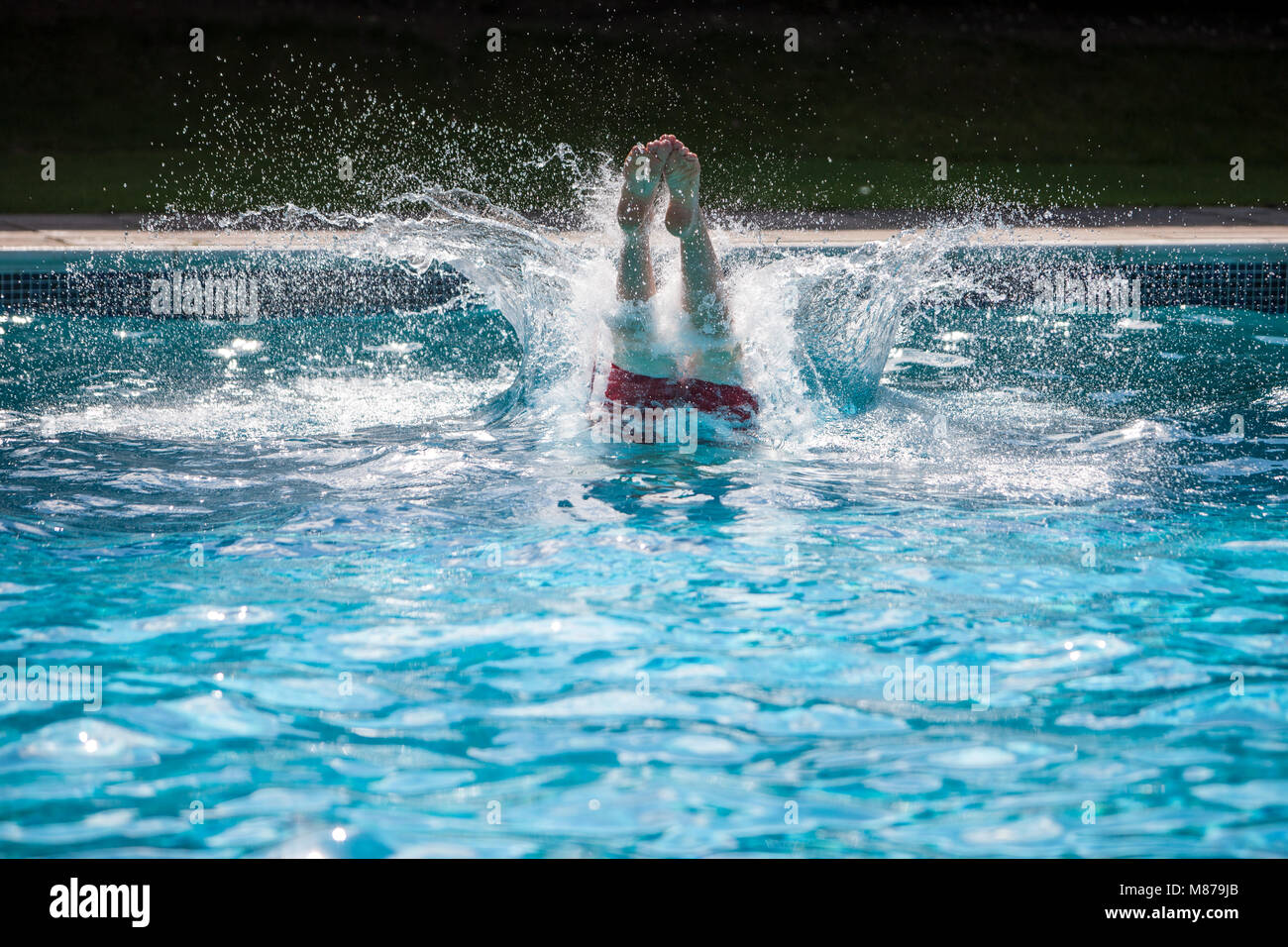 diving feet, diving into the deep pool - Stock Image
