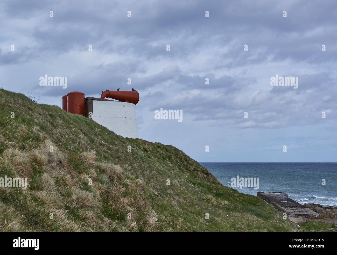 The Girdle Ness Foghorn in Aberdeenshire pointing east towards the North sea on a bright Spring day. - Stock Image