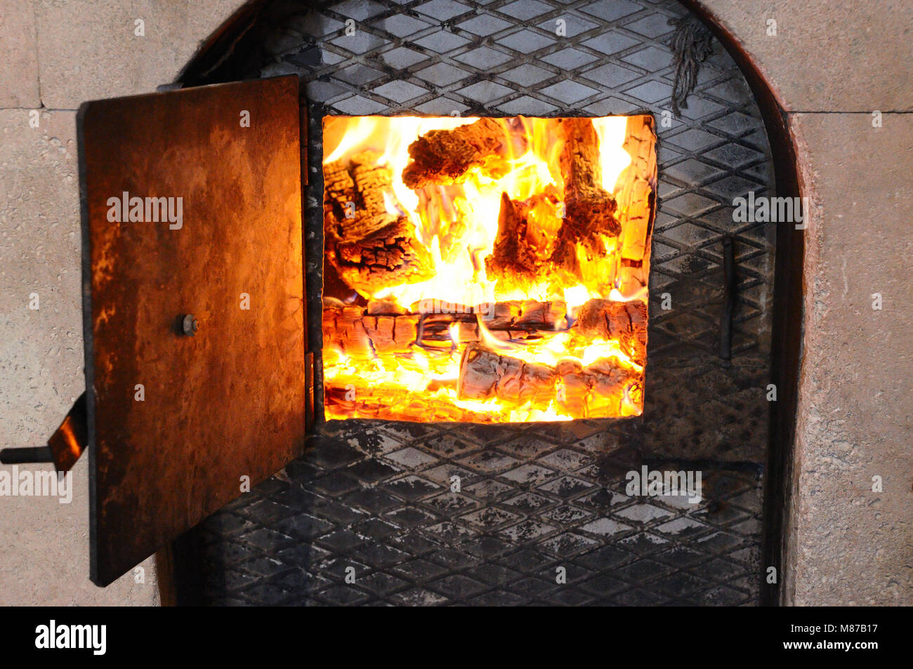 Wood fire in an stone stove - Stock Image