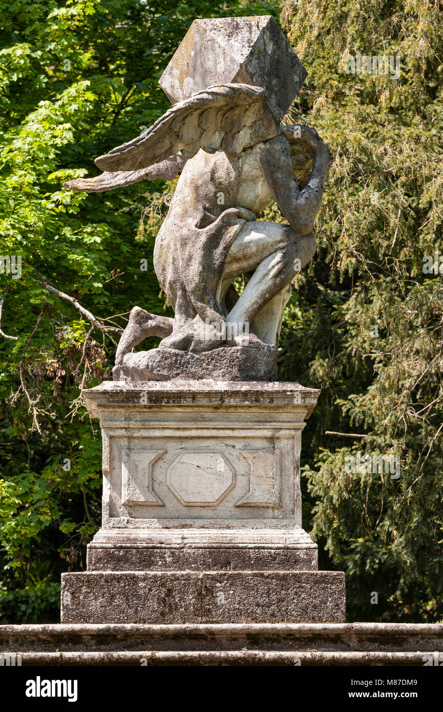 Valsanzibio, near Padua, Italy. A 17c statue of Time carrying a heavy burden, in the garden of Villa Barbarigo. - Stock Image