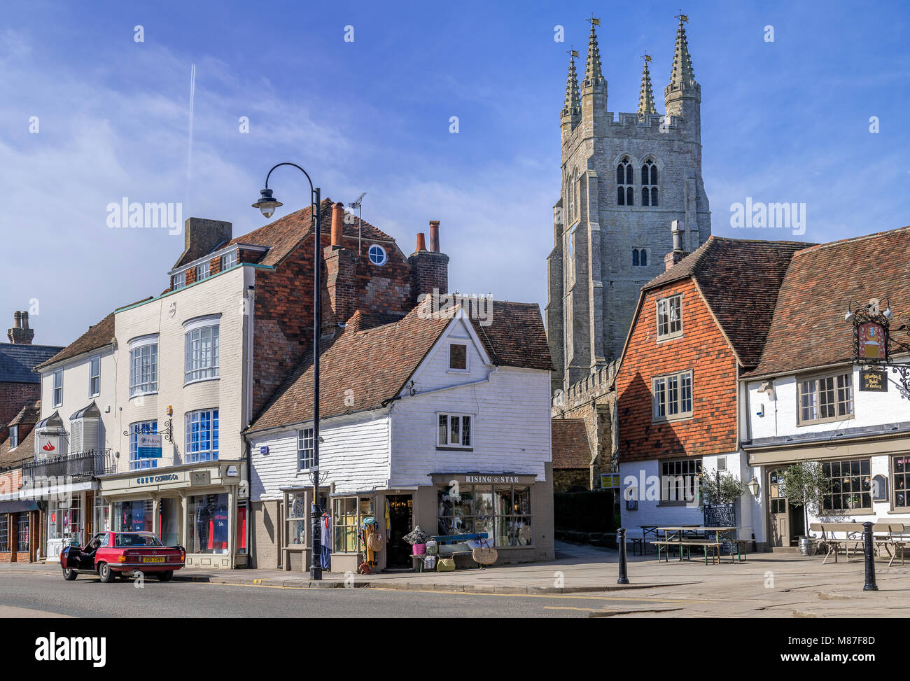 Tenterden high street with St Mildreds church dominating the skyline - Stock Image
