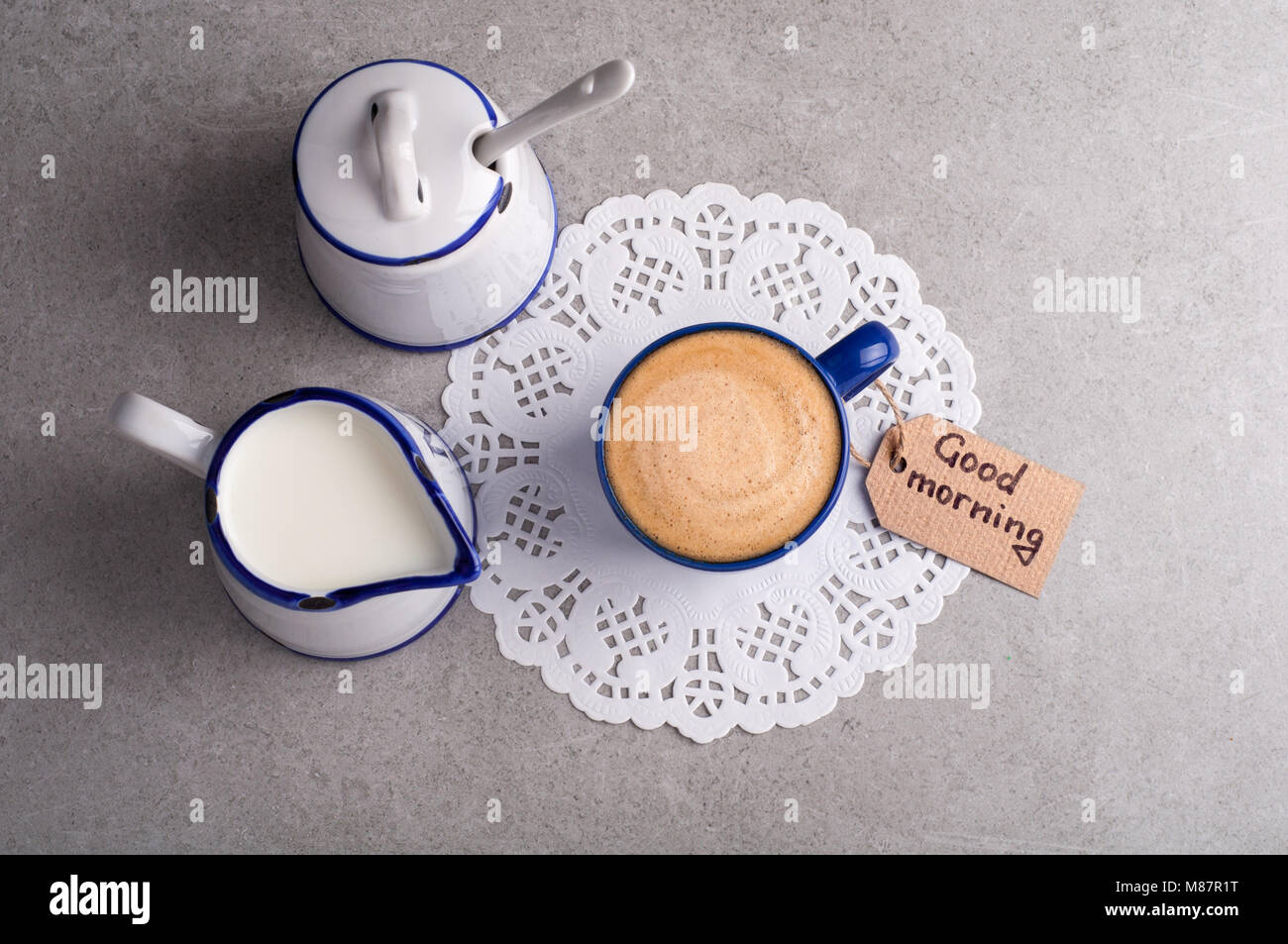 Coffe cup and note good morning. Breakfast concept. Top view - Stock Image