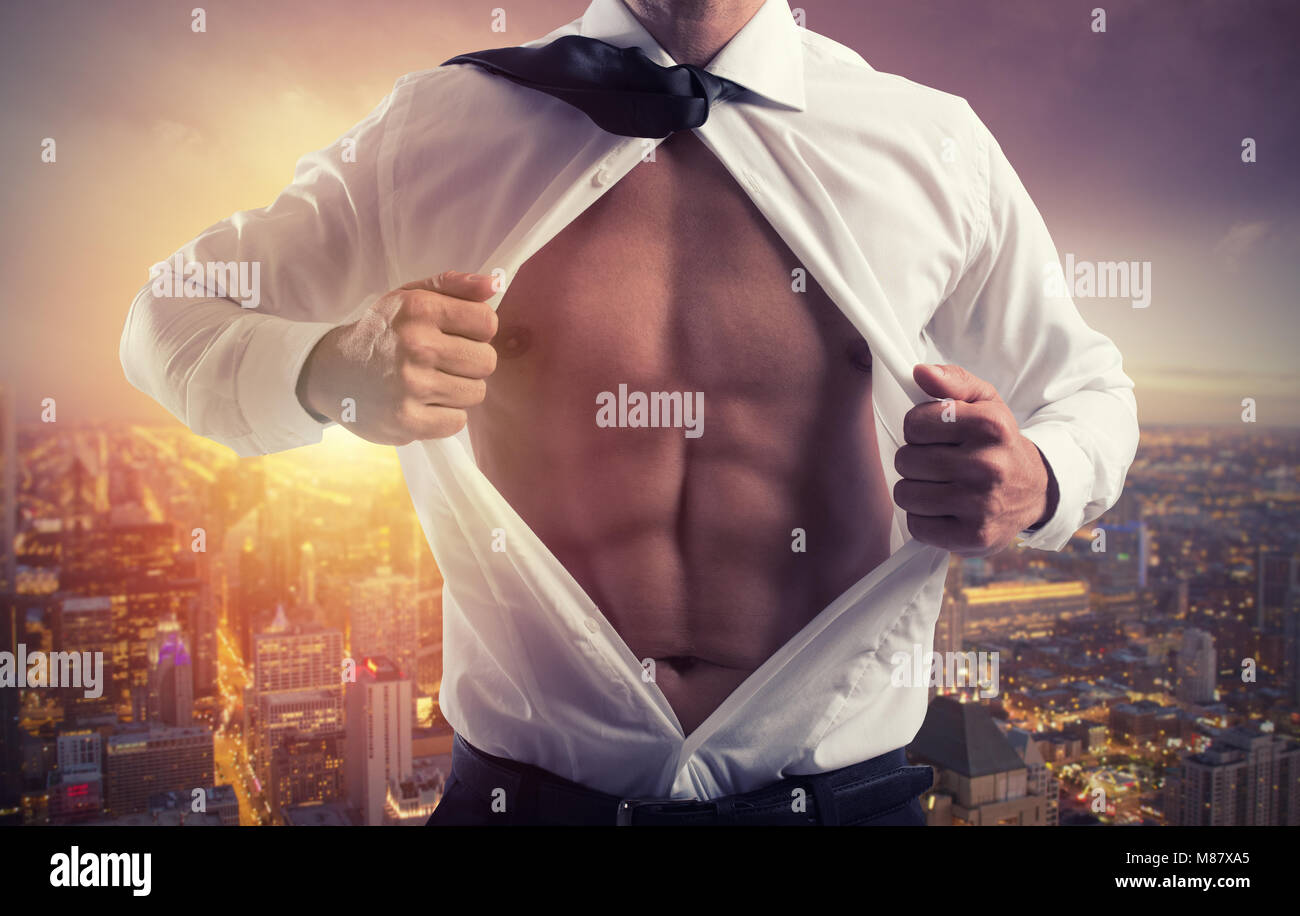 Businessman like a super hero. Concept of determination and success - Stock Image