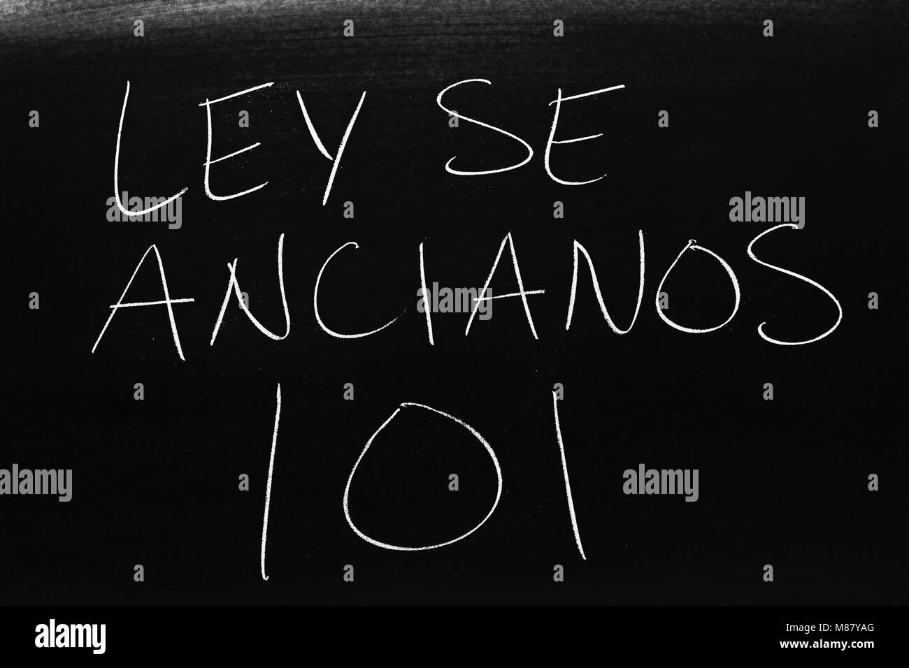 The words Ley Se Ancianos 101 on a blackboard in chalk - Stock Image