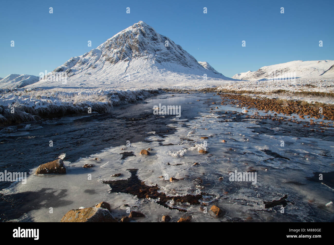An icy River Etive at the foot of the iconic Buacchaille Etive Mor which is Gaelic for The Herdsmen of Etive. This - Stock Image