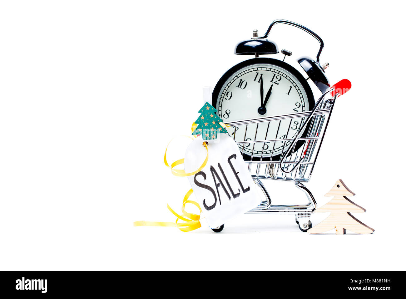 Image of trolley with golden alarm clock, Christmas tree, greeting card, ribbon Stock Photo