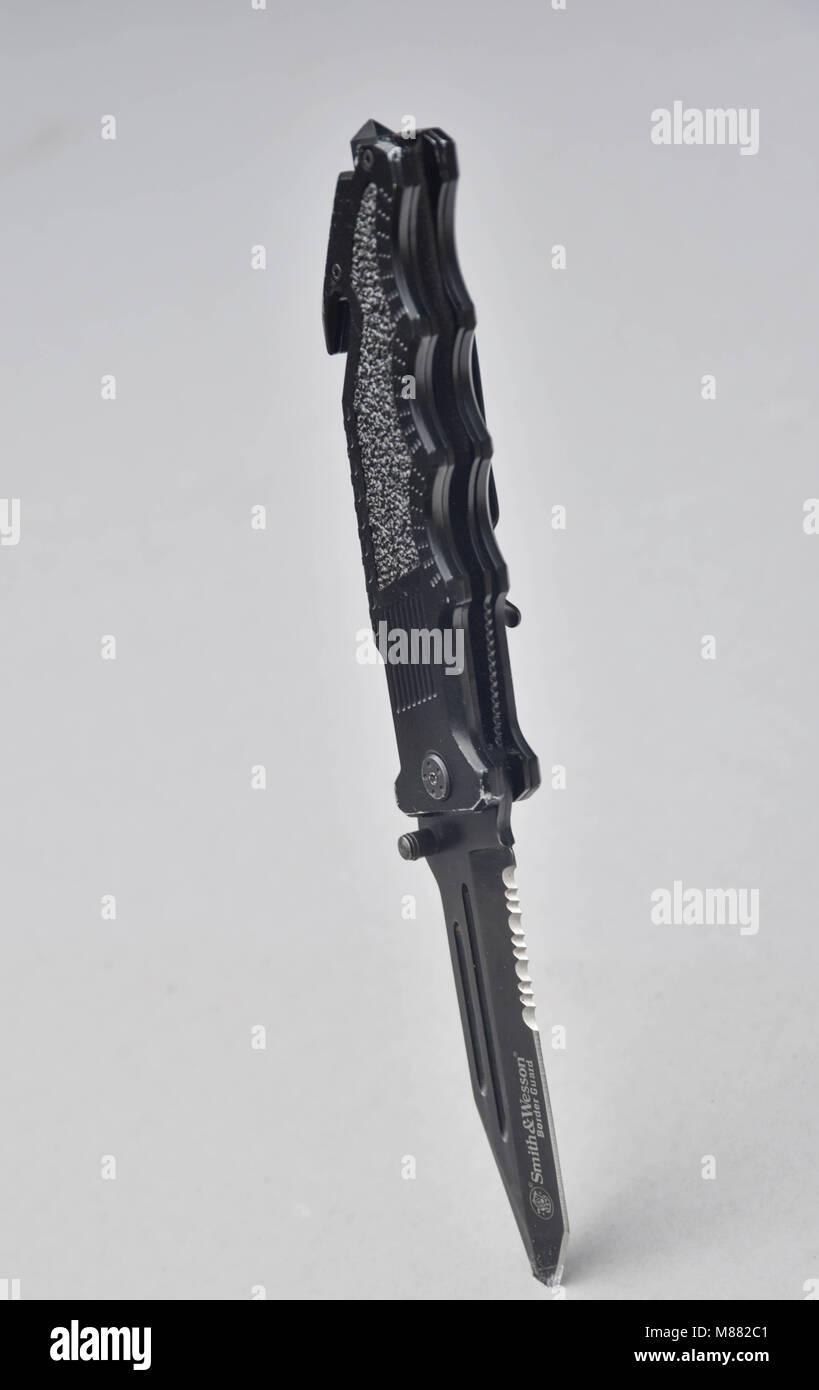 knife in board - Stock Image