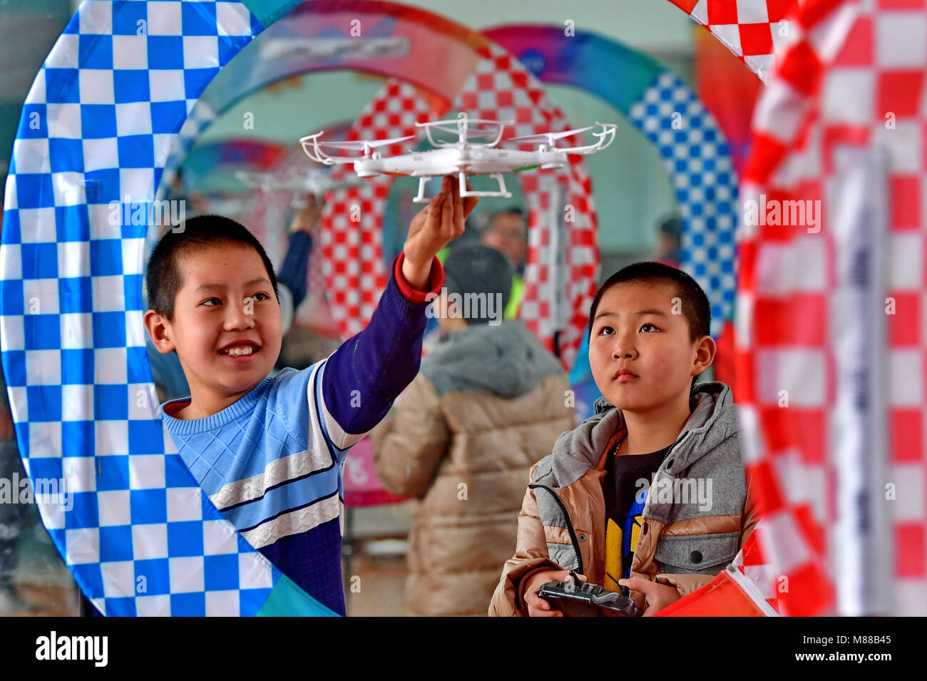Shijiazhuang, China's Hebei Province. 15th Mar, 2018. Students practice operating a drone at Kaiping Primary - Stock Image