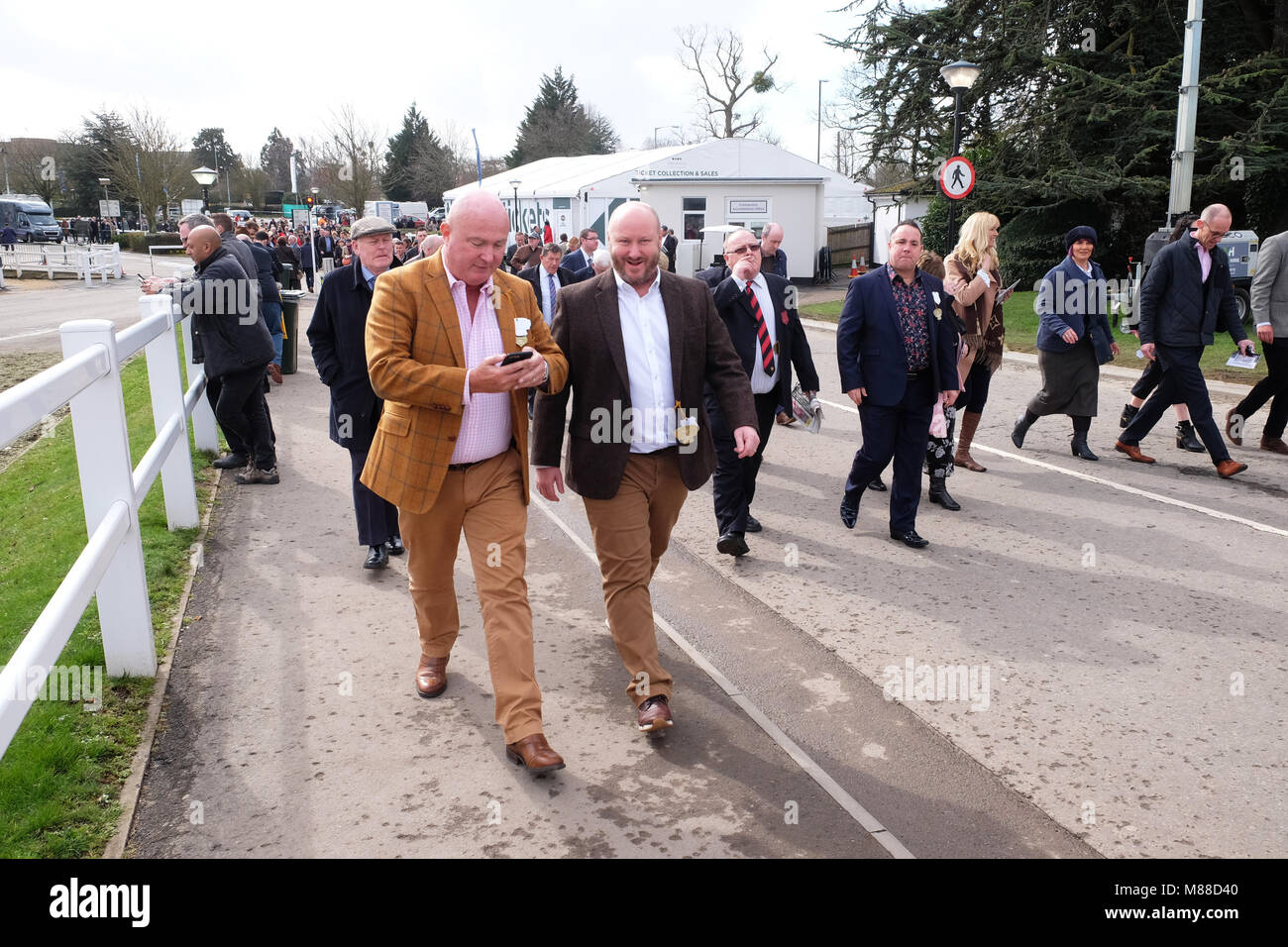 Cheltenham Festival, Gloucestershire, UK - Friday 16th March 2018 - Race goers arrive at the Cheltenham racing festival - Stock Image