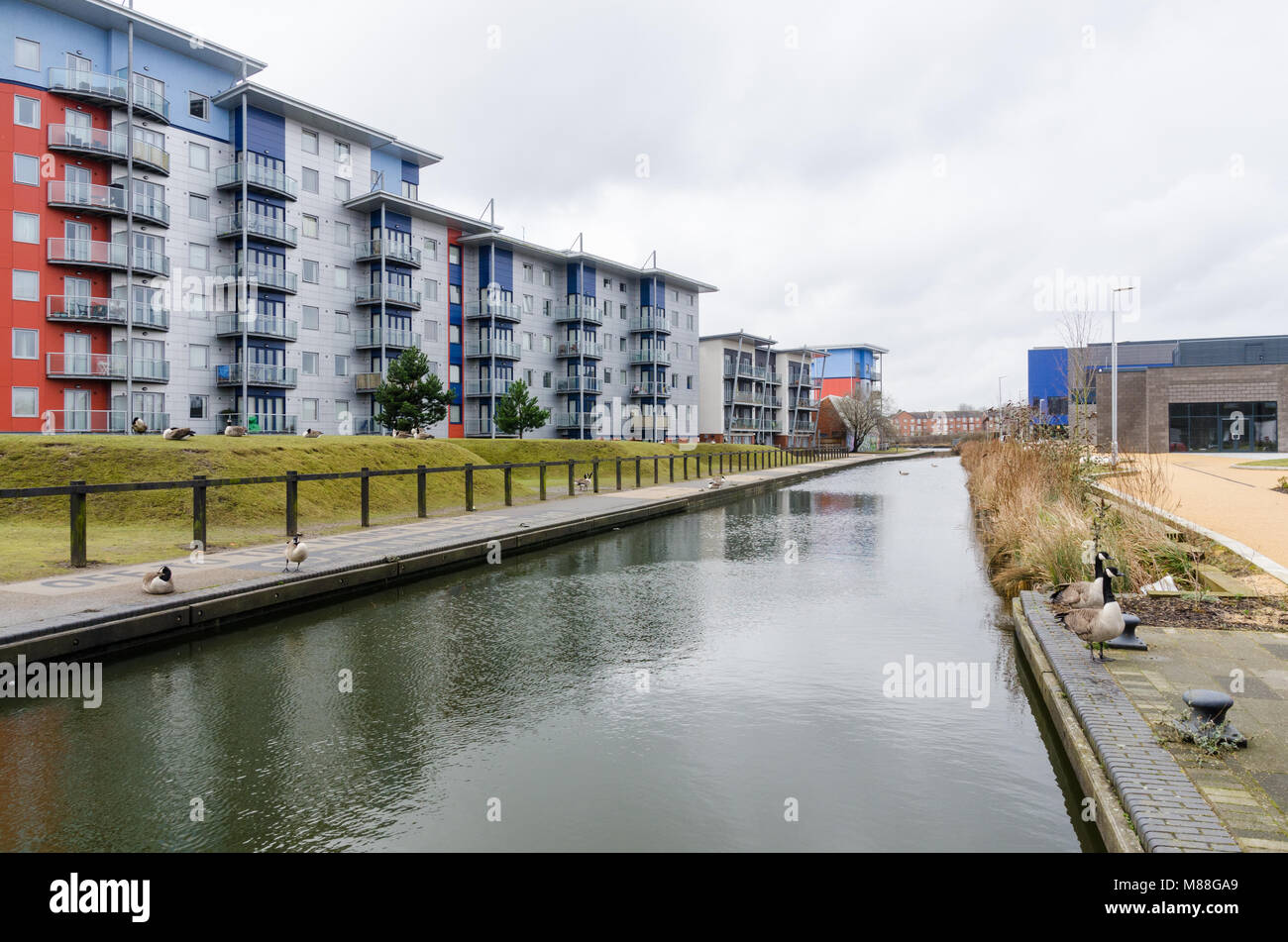 Modern canalside apartments in the West Midlands industrial town of Walsall - Stock Image