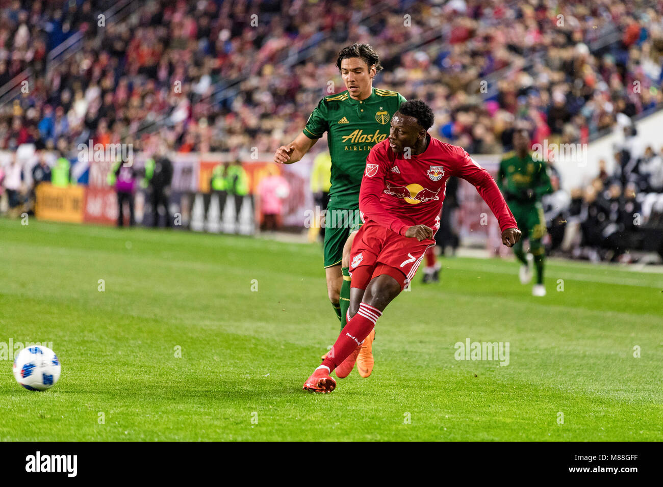 Derrick Etienne Jr. (7) plays a ball into the box in the first half against the Portland Timbers. The Red Bulls - Stock Image