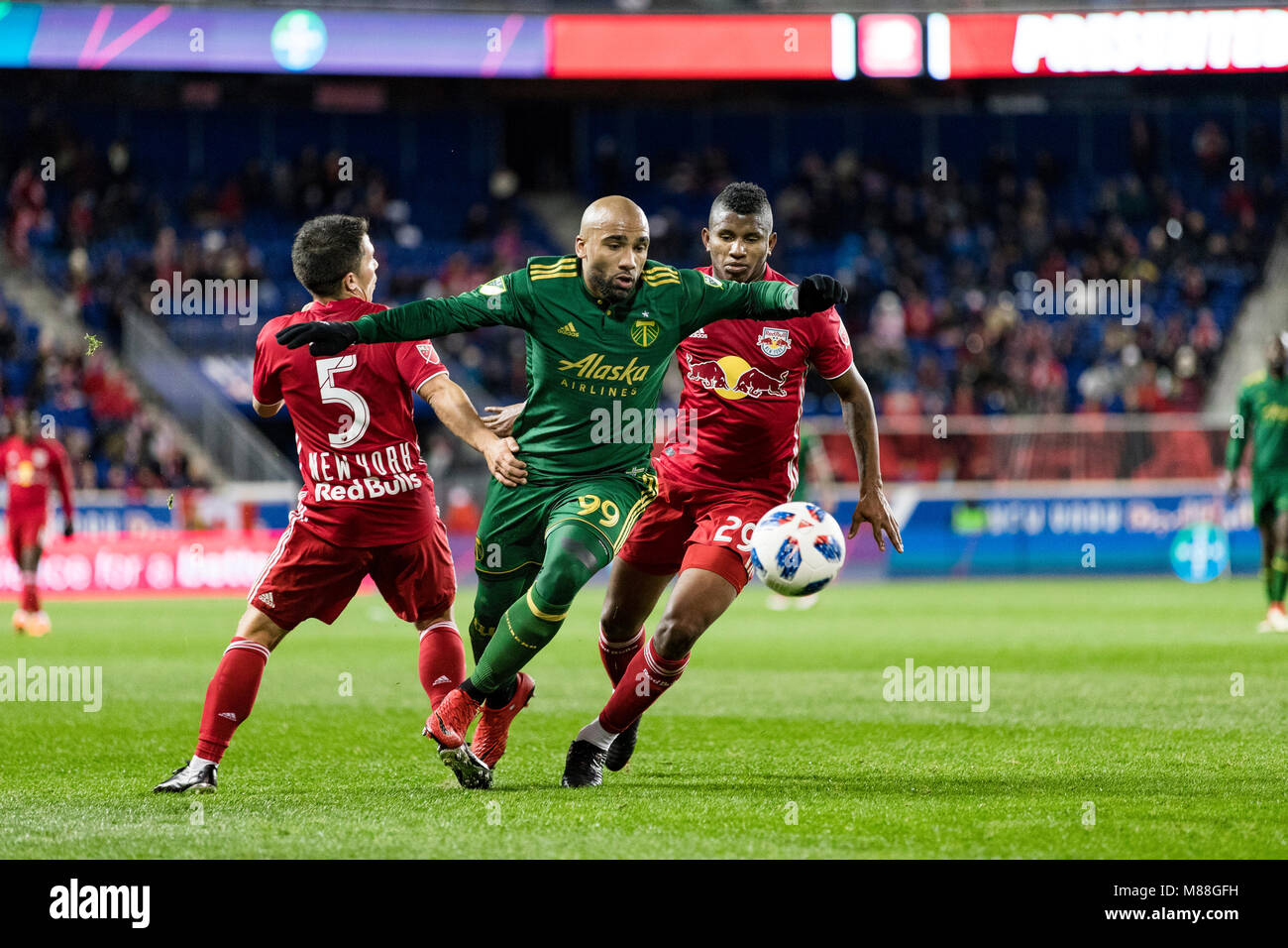 Samuel Armenteros (99) splits the defense in the Timbers 4-0 loss to the Red Bulls. - Stock Image