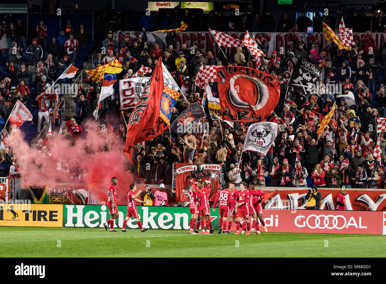 The Red Bulls celebrate a goal in their home opener in front of their supports against the Portland Timbers. The - Stock Image