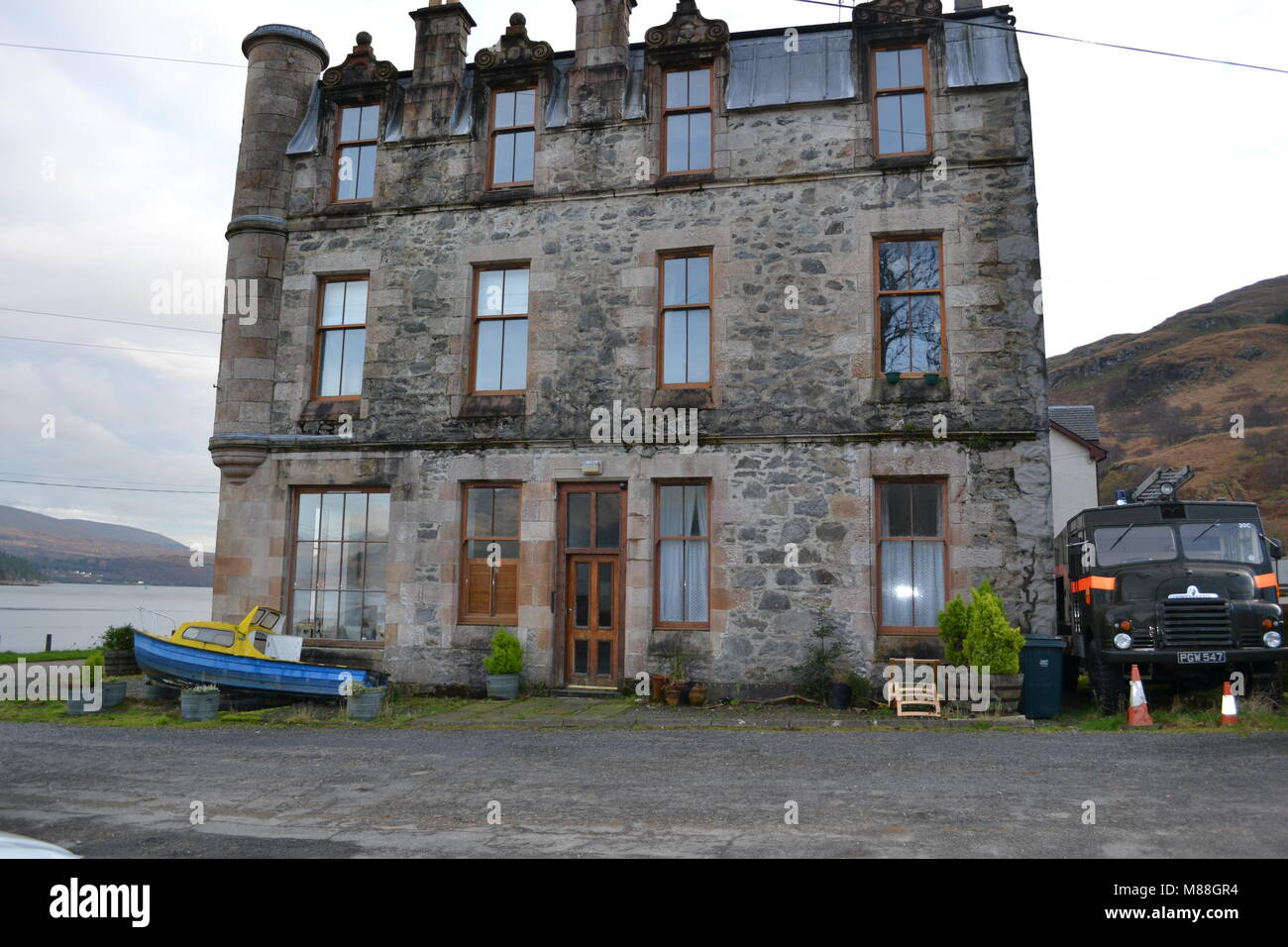 """carrick"" ""lochgoilhead"" ""Argyllshire"" ""Scottish highlands"" ""Scotland"" ""old fire engine"" ""old building"". Stock Photo"
