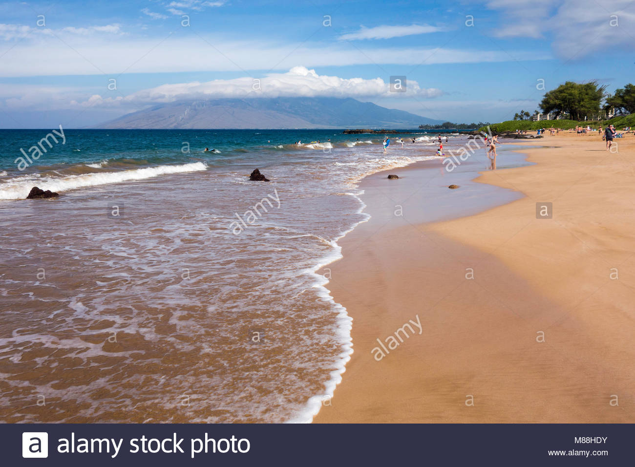 Gentle surf on Kamaole Beach Park 3 in Kihei on the island of Maui in the state of Hawaii USA - Stock Image