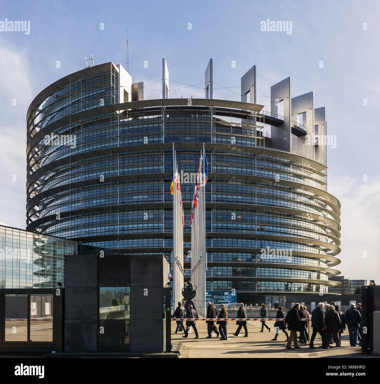 The Louise Weiss building, seat of the European Parliament, with tourists coming in, Strasbourg, France. - Stock Image