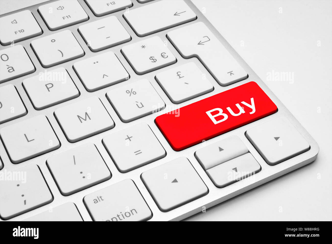 Red Buy button on a white keyboard isolated on a white background Stock Photo