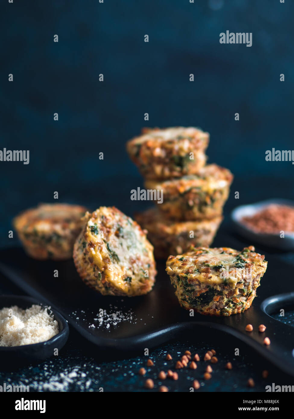 Buckwheat casserole with spinach, carrots, parmesan - Stock Image