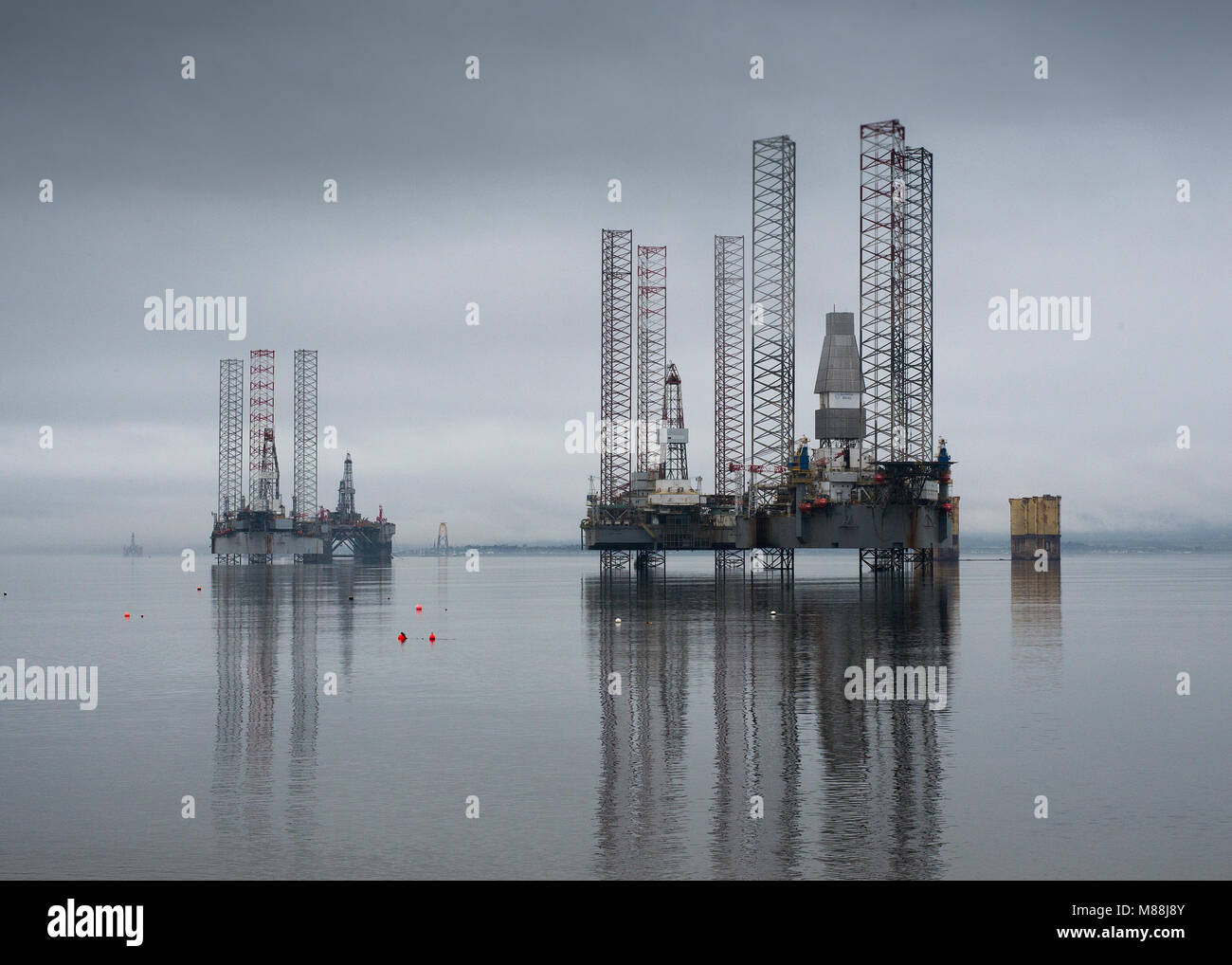 Oil rigs drilling platforms moored in Cromarty Firth viewed from town of Cromarty on the Black Isle in Ross & Cromarty, Highland Region, Scotland Stock Photo