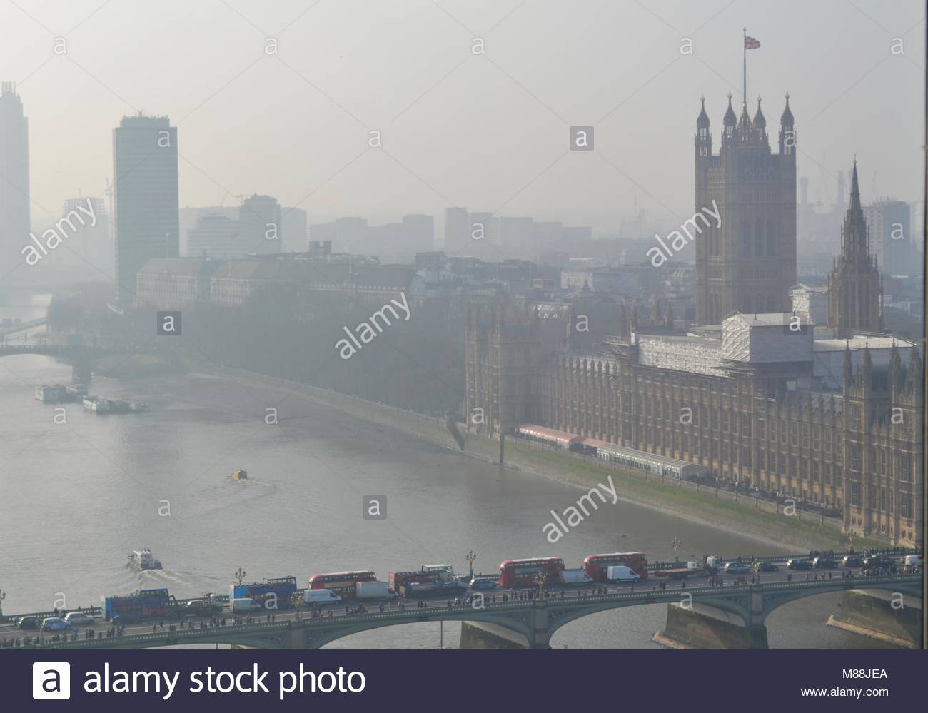 this is a photo of London,England covered in fog. it has the thames and the houses of parliament with the english - Stock Image