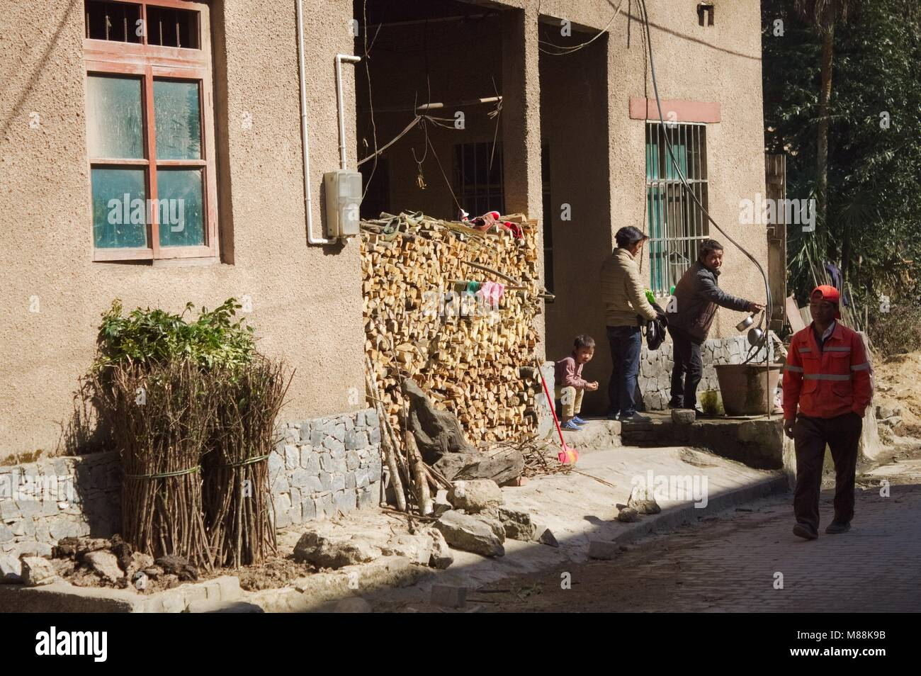 Duo Yi Shu Village, Yunnan, China - December 26 2017: A chinese family is working at home - Stock Image