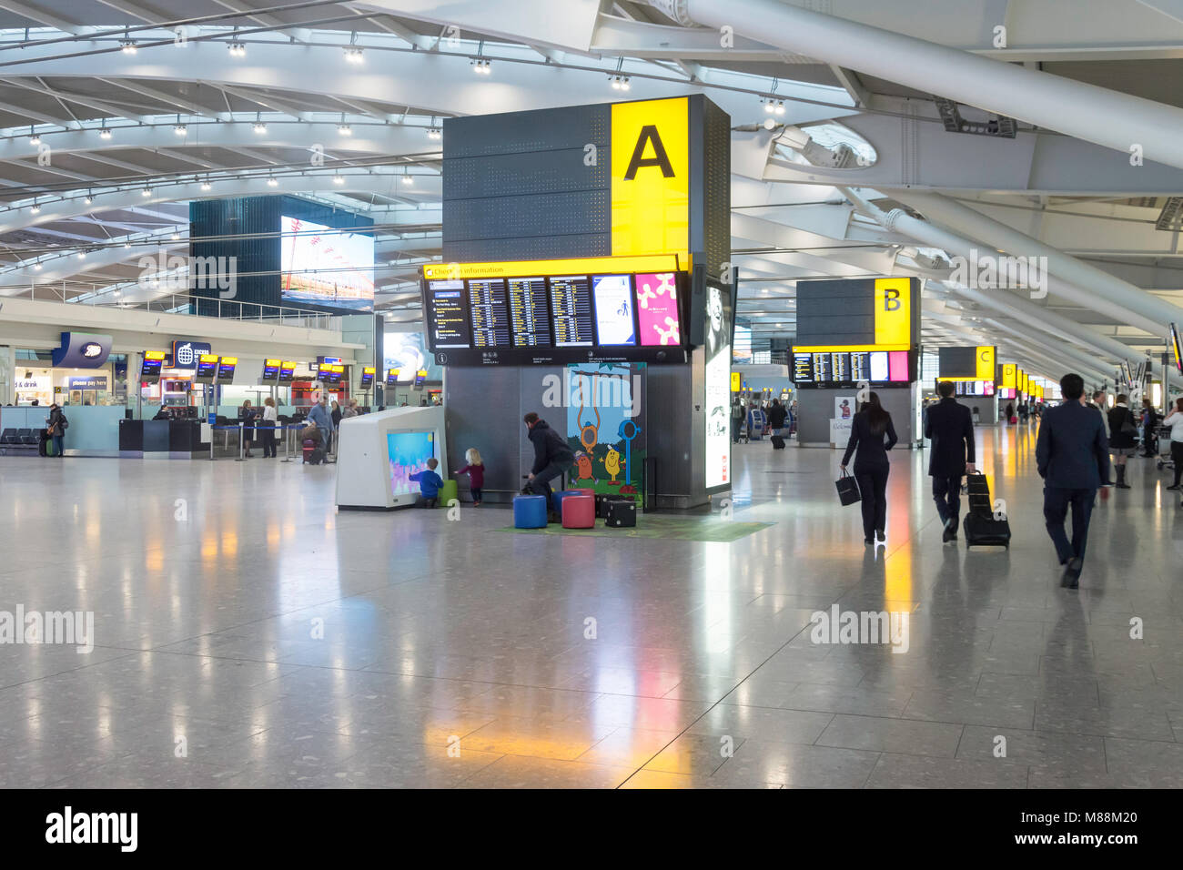 Departure level interior, Terminal 5, Heathrow Airport. London Borough of Hounslow, Greater London, England, United - Stock Image