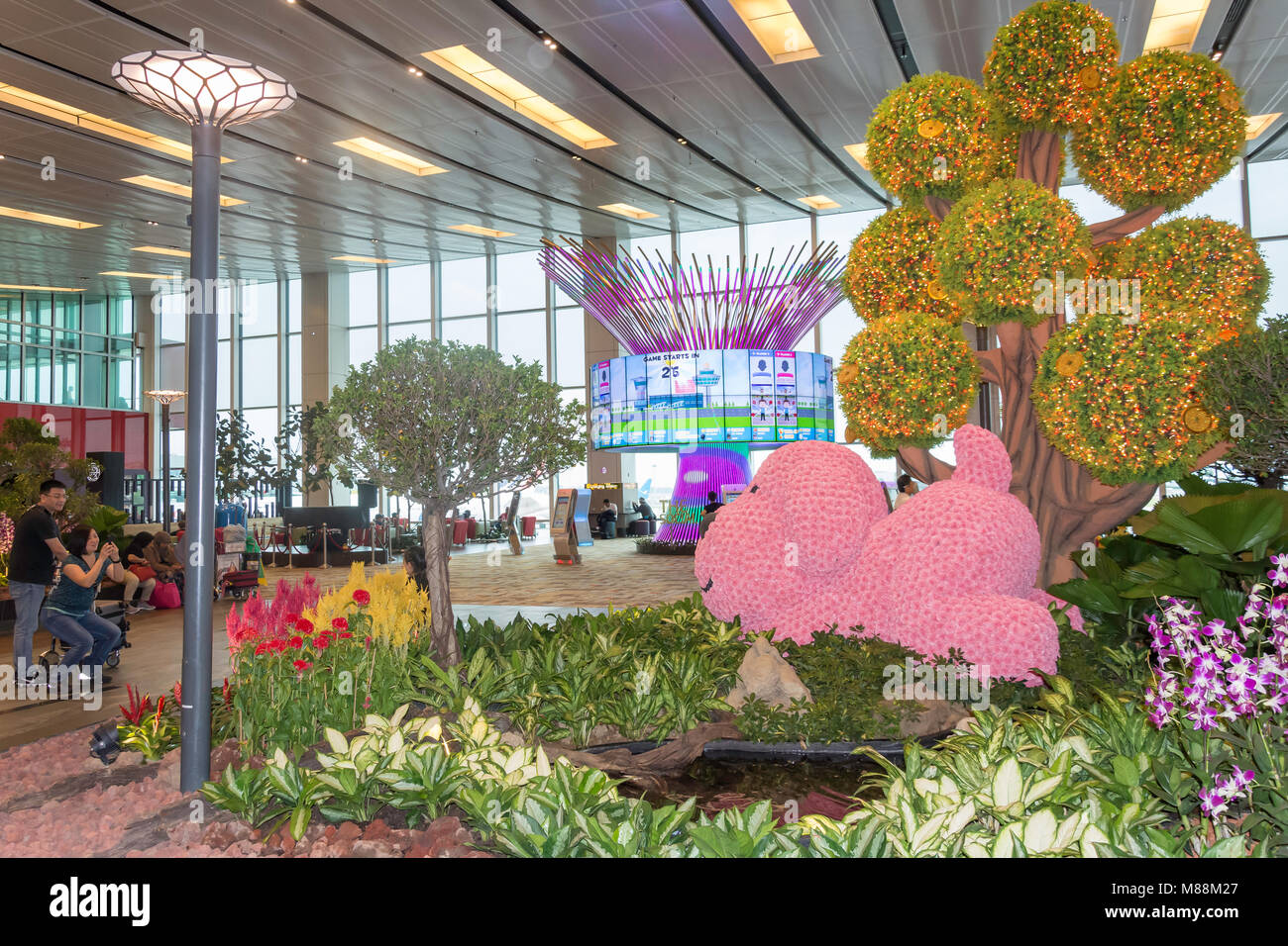 The Social Tree interactive installation and garden in Transit Hall, Terminal 1, Singapore Changi Airport, Changi, - Stock Image
