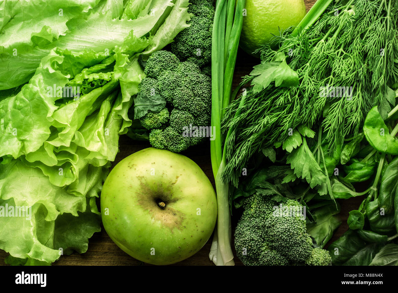 Green vegetables, fruits and greenery food background. Top view Stock Photo