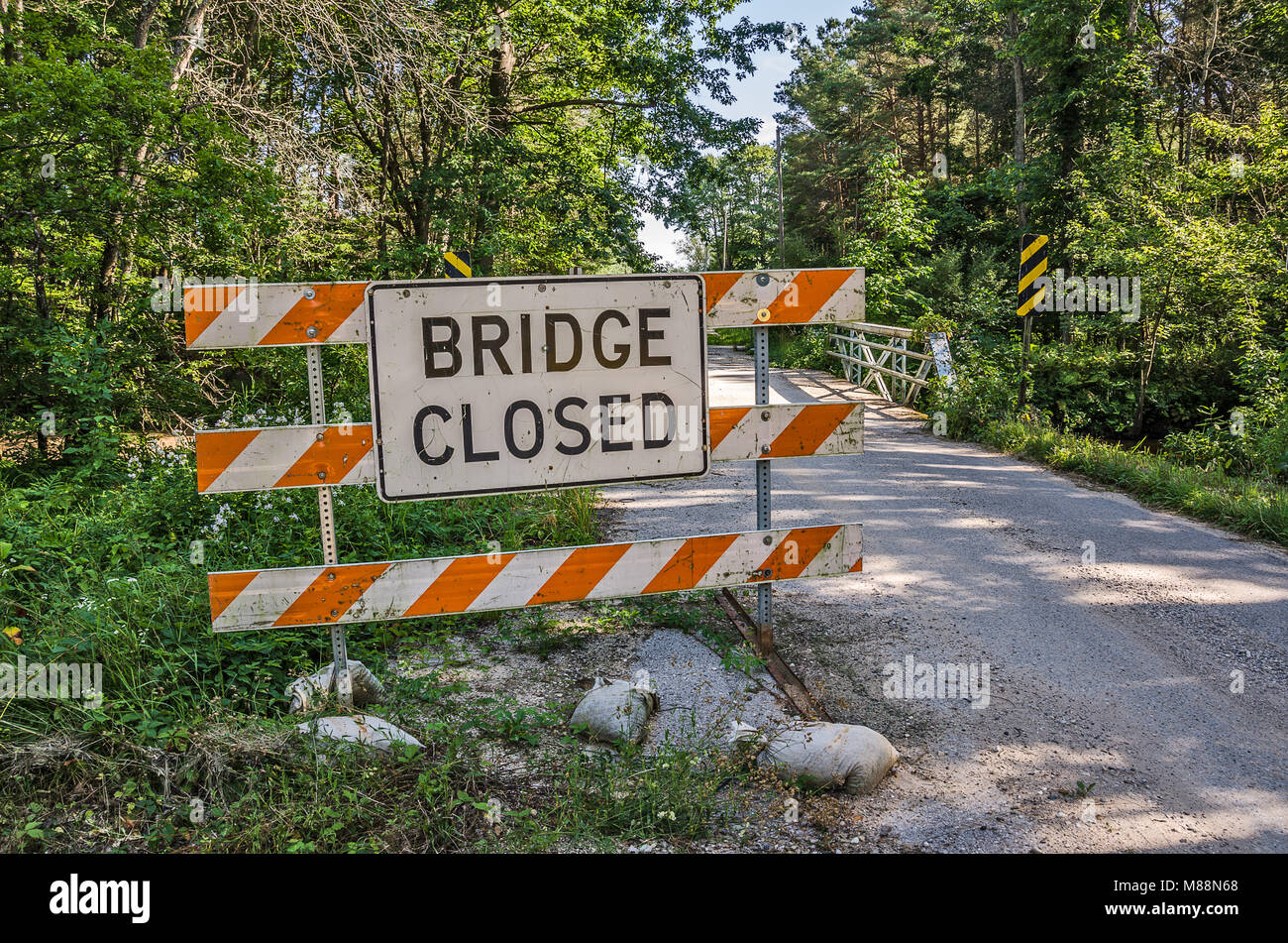 Who moved the sign?  This is sending a mixed message.  Is the bridge closed or open? - Stock Image