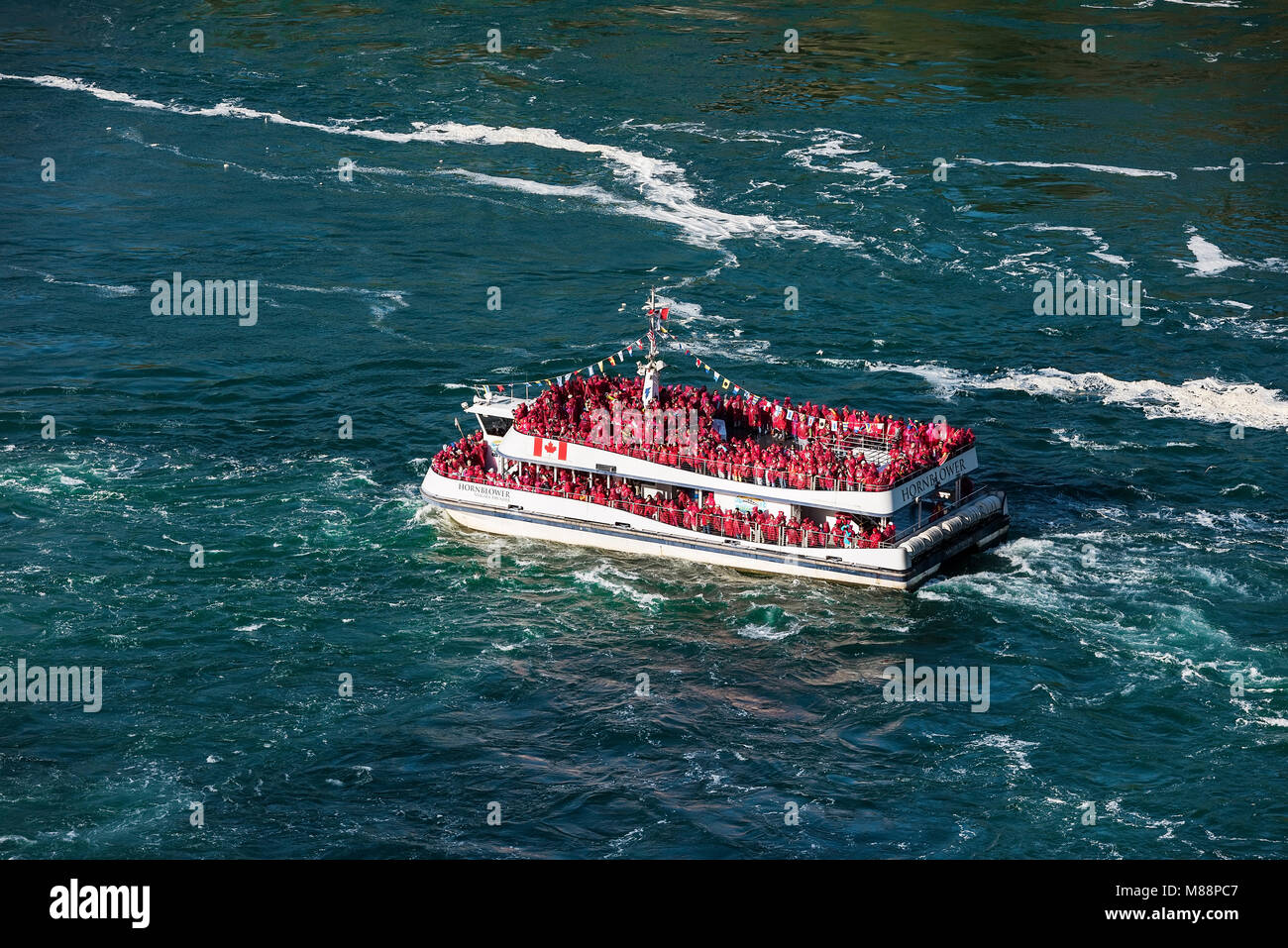 Sightseeing boat approaches Horseshoe Falls, Niagra Falls, Ontario, Canada - Stock Image