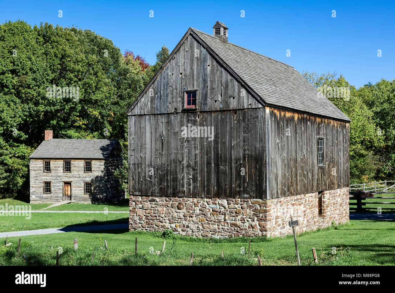 Barn and house, Genesee Country Village and Museum, Mumford, New York, USA. - Stock Image