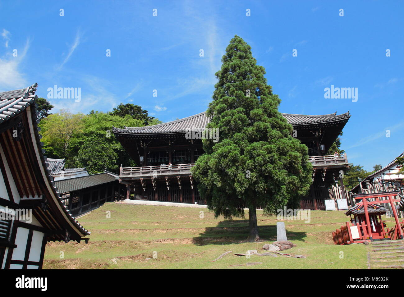 View of amazing ancient architecture of Nigatsu-do Hall above the Todaiji temple complex in Nara, Japan - Stock Image