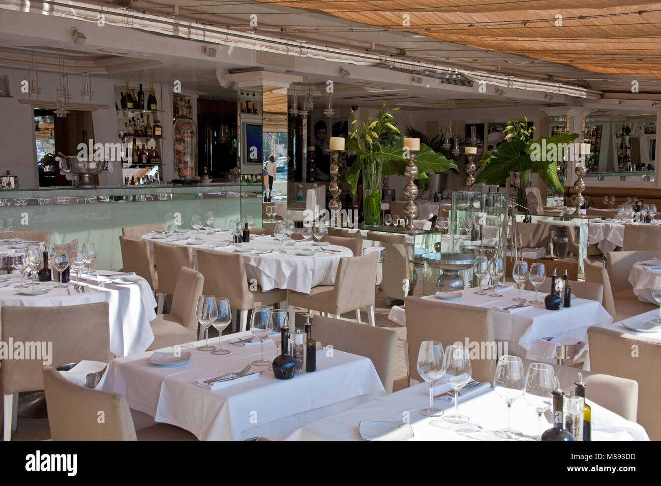 Laid tables at restaurant Joseph L'Escale at at harbour promenade of Saint-Tropez, french riviera, South France, - Stock Image