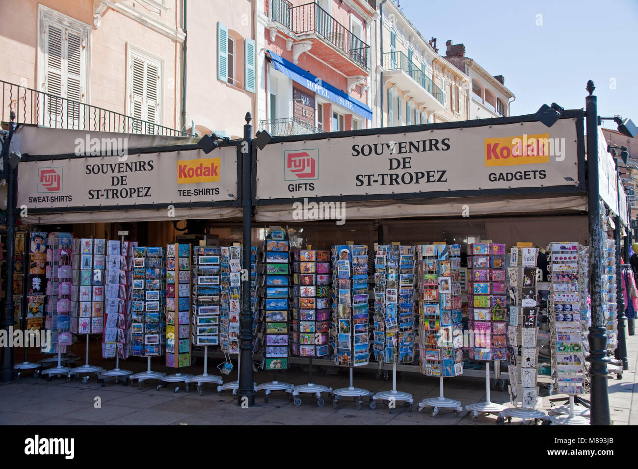Souvenir shop with picture postcards, strolling promenade at harbour of Saint-Tropez, french riviera, South France, - Stock Image