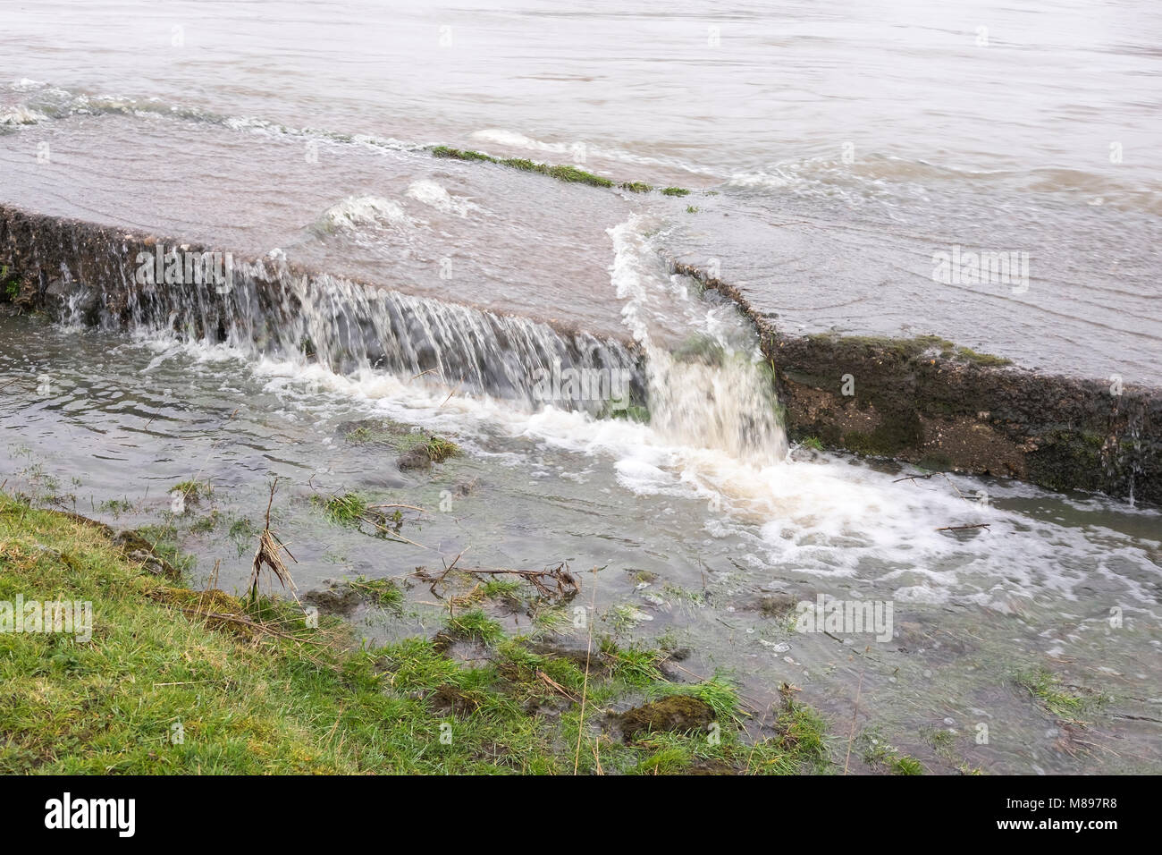 Flood water pouring in at Sawley Weir, Derbyshire, UK - Stock Image
