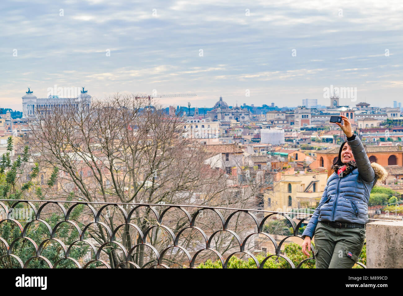 ROME, ITALY, DECEMBER - 2017 - Woman taking a selfie at monte pincio viewpoint at Villa Borghese - Stock Image