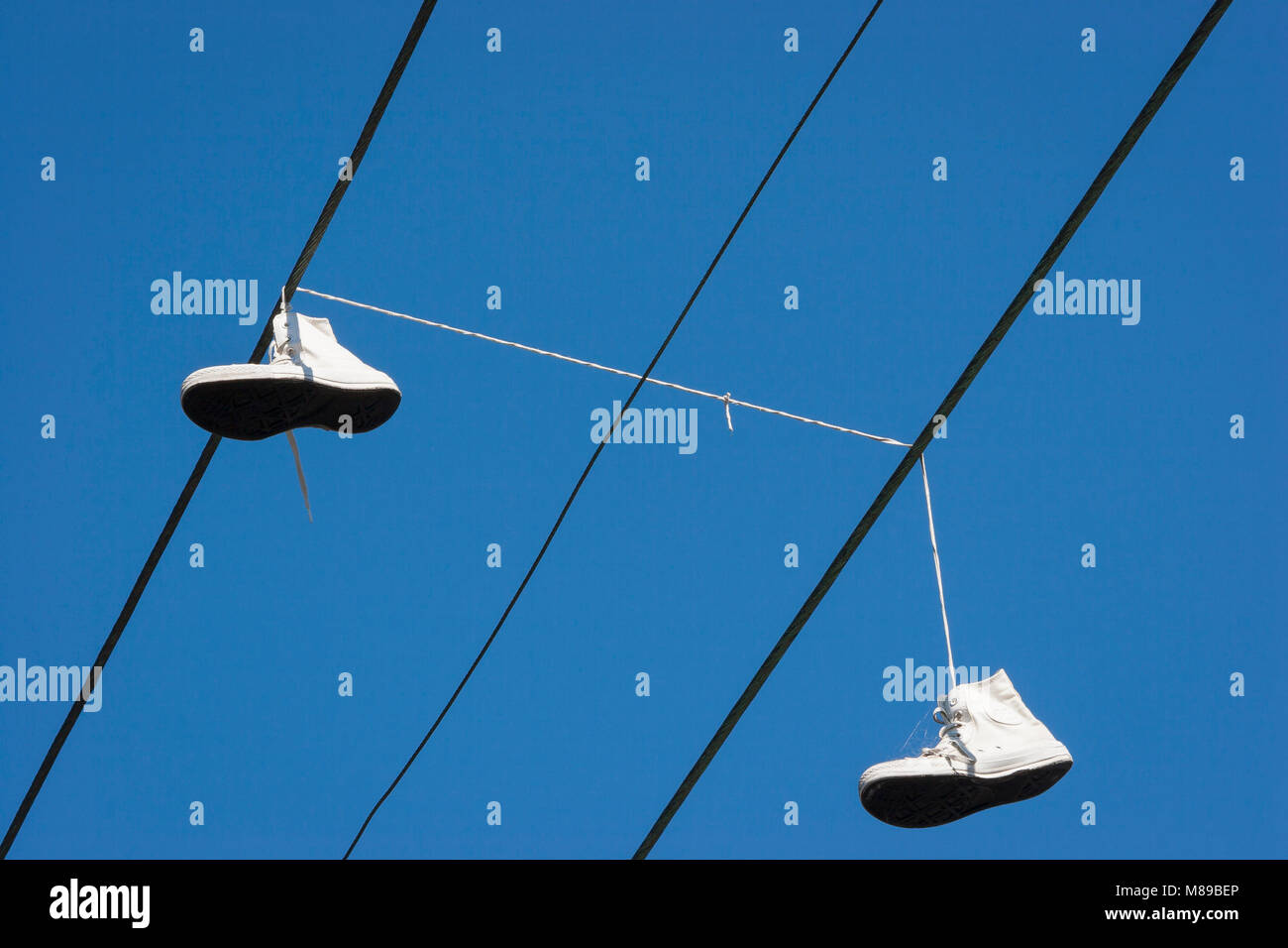 Shoes hanging on power wires. Melbourne, Australia. - Stock Image